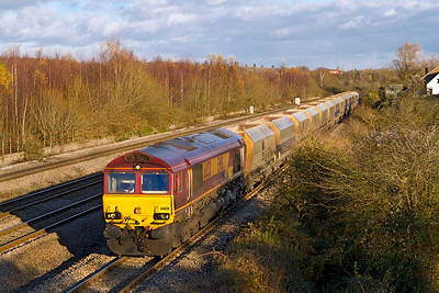 66031 heads along the 'down' slow at Church Road, Undy with 6B35 10.47 Hayes & Harlington Tarmac Sidings to Moreton-on-Lugg stone empties. Wednesday 5th December 2012.