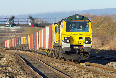 Even though its a cold December morning, 70020 is creating quite a heat haze as climbs past Pilning with 4O51 09.58 Wentloog to Southampton Millbrook Freightliner. Wednesday 5th December 2012.
