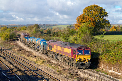 66168 & 66027 drop down off the Bishton Flyover with 3S59 07.46 Moreton-on-Lugg to Weston-super-Mare RHTT. Thursday 8th November 2012.