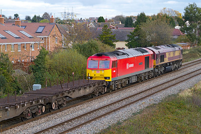 66131 has 60059 'Swinden Dalesman' dead in tow on 6E66 11.00 Margam to Scunthorpe empty steel carriers passing Portskewett. Thursday 8th November 2012.