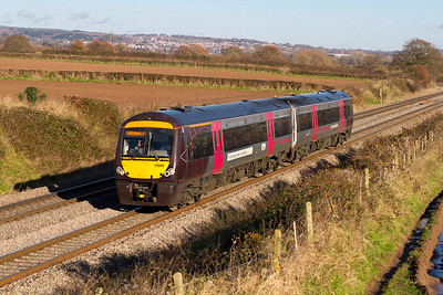 2 car 170111 forming the 1V07 10.11 Nottingham to Cardiff Central south of Lydney. Wednesday 5th December 2012.