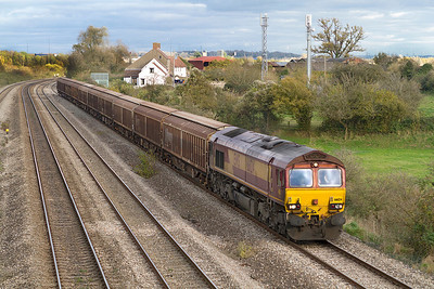 66124 heads along the 'slow' at Church Road, Undy with 6V47 10.13 Tilbury to Trostre empty cargo vans. Thursday 8th November 2012.