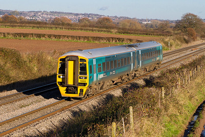 Arriva Trains Wales 2G55 11.46 Cheltenham Spa to Maesteg service formed of 158822 is south of Lydney. Wednesday 5th December 2012.