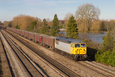 56312 passes Hinksey Yard on the exit from Oxford with 6Z91 10.55 Calvert to Didcot Power Station empty flyash wagons. This working is operated by DBS but due to a shortage of Class 66's because of the RHTT season the power has been sub-contracted to British & American Railway Services. Thursday 29th November 2012.