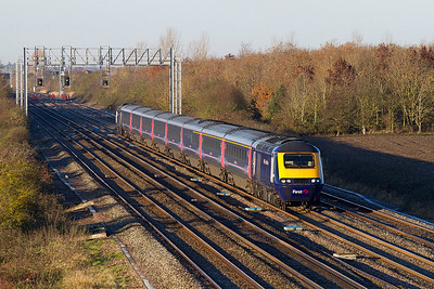 The track workers return to their duties in the background as a Paddington bound First Great Western HST passes Denchworth with power cars 43093 & 43168. Thursday 29th November 2012.