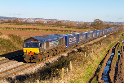 Ex Fastline 66303 running about an hour late heads 4V38 08.22 Daventry to Wentloog Tesco Express south of Lydney. Wednesday 5th December 2012.