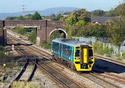 The 09.17 Maesteg to Cheltenham Spa formed of 158821 in the new Arriva Trains Wales livery passes Magor on the fast. 20/10/2011