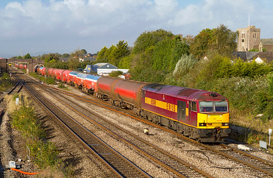 Still hanging on in the original E W & S livery 60049 passes Magor Village with 6B13 05.04 Robeston to Westerleigh loaded Murco tanks. Wednesday 17th October 2012.