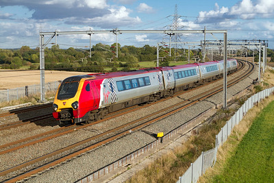Super Voyager 221143 forming the 1D89 15.10 Euston to Chester passes Lichfield Trent Valley. Friday 12th October 2012.