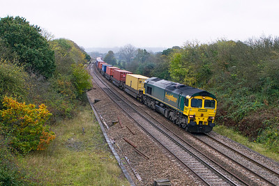 66505 passes Ram Hill, Coalpit Heath with 4V50 10.57 Southampton Millbrook to Wentloog Freightliner. Thursday 25th October 2012.