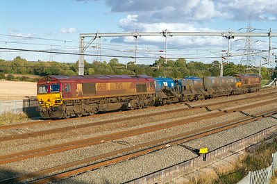 The WCML Wembley Euro Terminal based Rail Head Treatment Train returns from Macclesfield past Lichfield Trent Valley with 66138 & 66232 providing the power with FEA's 642024 & 642047. Friday 12th October 2012.