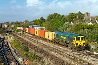 Heavy Hauls 66525 has charge of a Freightliner container train as it passes Magor village with 4O51 09.58 Wentloog to Southampton Maritime Container Terminal. 17th October 2012.