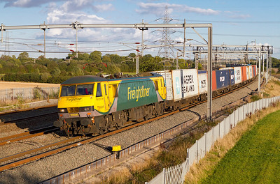 Powerhaul liveried 90049 heads 4M87 11.14 Felixstowe to Trafford Park Freightliner past Lichfield Trent Valley. Friday 12th October 2012.