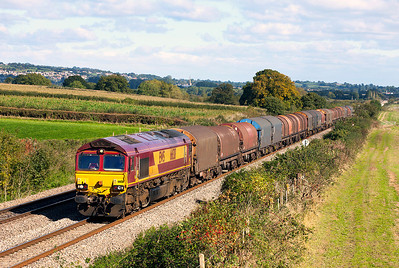 66138 passes Woolaston with 6V05 10.01 Round Oak to Margam empty steel carriers. Thursday 10th October 2013.