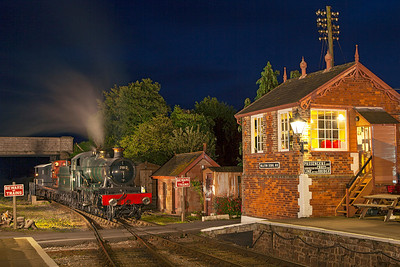 A David Williams photo charter with 7812 'Erlestoke Manor' and Talyllyn/Corris Railway No.3 on a Weldrol wagon replicating how the narrow gauge locomotives were conveyed to works at Oswestry or Swindon for overhaul. Williton West Somerset Railway, Friday 4th October 2013.