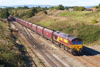 66160 climbs past Pilning village with 4C70 10.50 Aberthaw Power Station to Avonmouth empty coal hoppers. Thursday 10th October 2013.