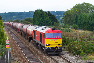 60062 'Stainless Pioneer' drops down grade past Pilning with 6B33 13.00 Theale to Robeston empty Murco tanks. Thursday 12th September 2013.
