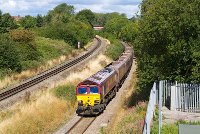 66075 climbs up the split level section on the exit from Patchway Tunnel with 4C55 09.08 Aberthaw Power Station to Avonmouth with empty hoppers. Saturday 7th September 2013.