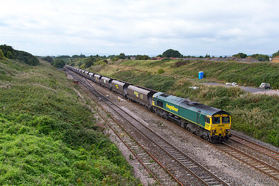 66519 climbs away from the Severn Tunnel past Pilning village with 4V22 09.30 Fiddlers Ferry Power Station to Stoke Gifford Yard. Thursday 12th September 2013.