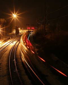 Late night Amtrak train snaking through the Cumberland rail yard