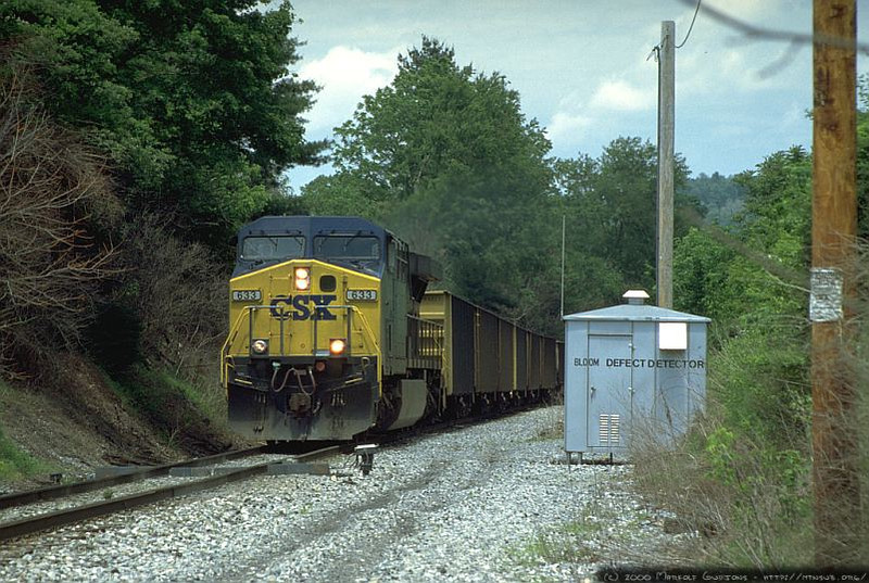 AC60CW 633 leading a T104 empty to Robinson Run, WV. 2000.