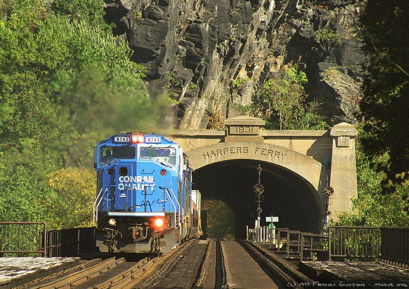 """CSX SD60I 8743 leading a westbound """"Jet"""" at Harpers Ferry, WV. 1999."""