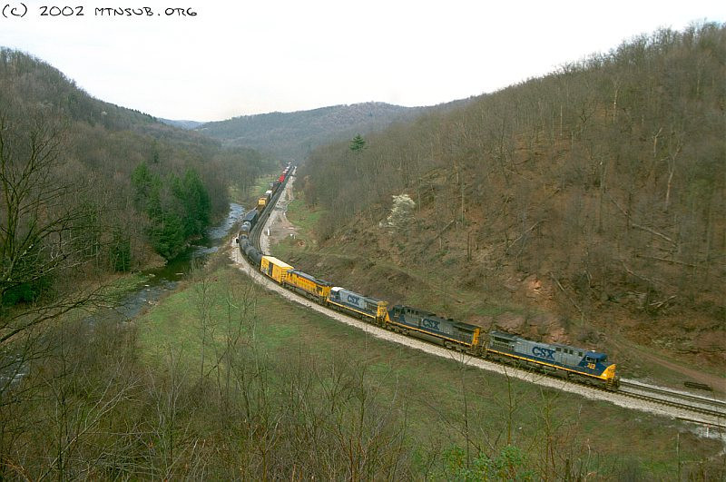 A solid GE lashup including a Union Pacific and a CSX Dash-7 on a manifest at Foley, PA. April 2002.