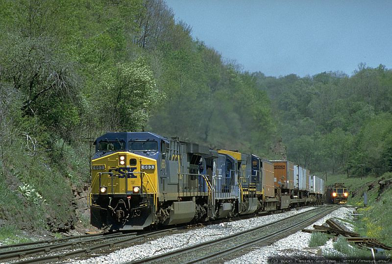 Westbound Q100-series intermodal cresting the grade at Sand Patch, PA. 2000.