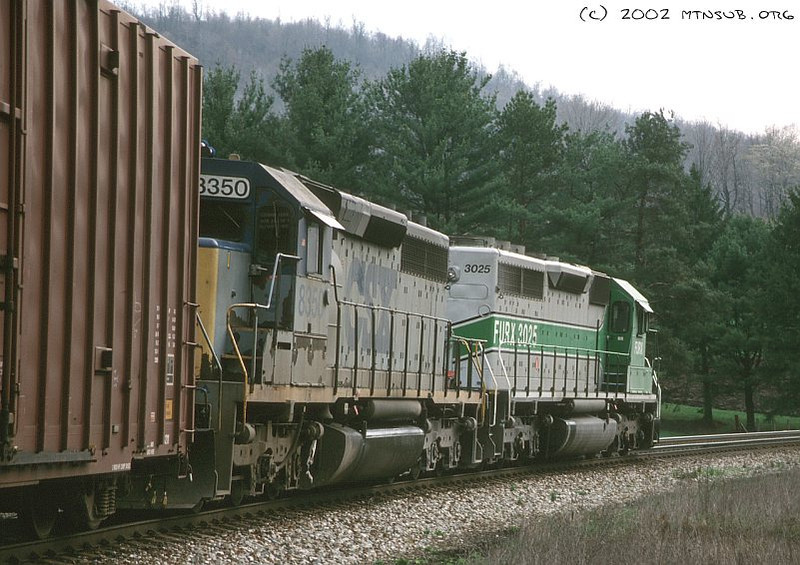"Classic power! A ""Furby"" and a YN1-SD40-2 lead an eastbound manifest downgrade at Mance, PA. April 2002."