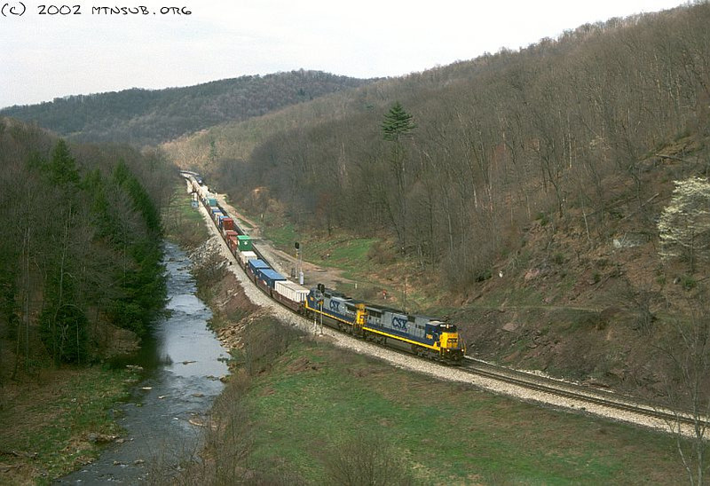 Eastbound stacks about to be overtaken by Amtrak P030 running wrong main at Foley, PA. April 2002.