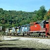Wild lashup with two Connellsville helpers on the head end of a Q300-series train at Fairhope, PA. 1999.