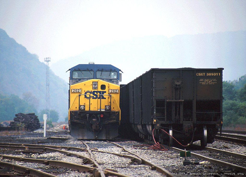 During the great post-Conrail merger meltdown of 1999, AC44CWs 262 and 31 are tied down with a coal train in Keyser, WV. A second train is on yard air. 1999.
