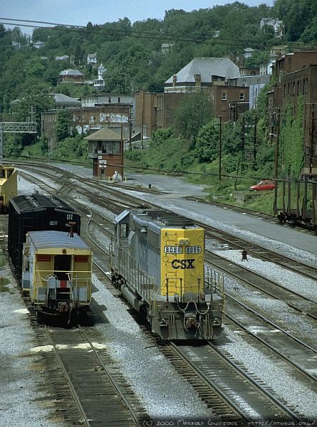 SD40-2 8086,caboose, and a locomotive sand hopper in Grafton, WV. 2000.