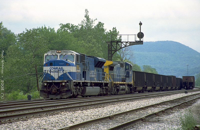SD80MAC and C40-8W 7908 with coal empties at Z Tower, West Keyser, WV. 2002.