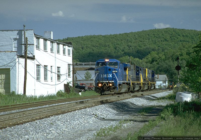 A set of light power led by C40-8W LMSX 718 westbound at Terra Alta, WV. 2000.