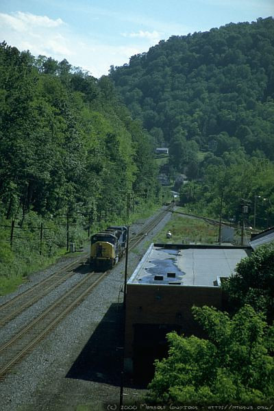 After dropping the two rear SD70MACs at Mc Millian to tie onto the head end of the loaded coal train, LMSX 718 and a third SD70MAC continue west to back against the train as helpers. M&K Jct., WV. 2000.