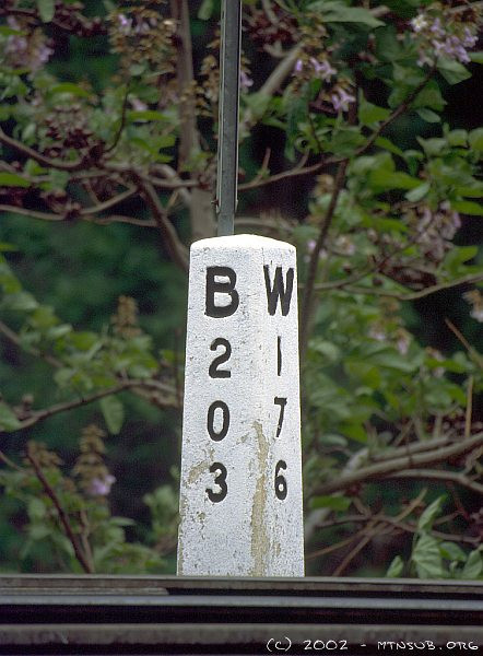 Mile marker (203 miles to Baltimore, 176 miles to Wheeling) at Z Tower, West Keyser, WV. 2002.