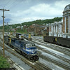 SD80MAC 0804 and C40-9W 9033 move into the engine service facility after dropping the emtpy coal cars on the right in Grafton, WV. 2000.