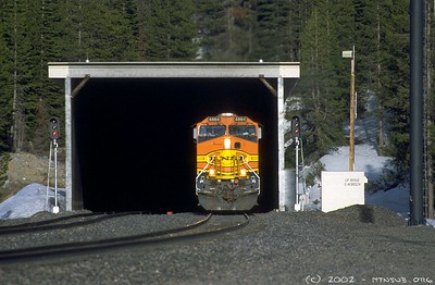 A BNSF C44-9W leads a westbound manifest out of Tunnel 41 at East Norden. This is the summit of the new alignment.