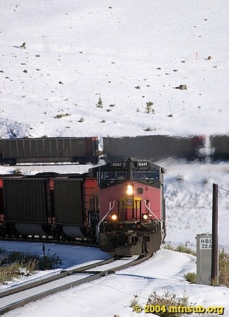 A loaded coal train in full dynamics approaches the hotbox detector at MP 22.6.
