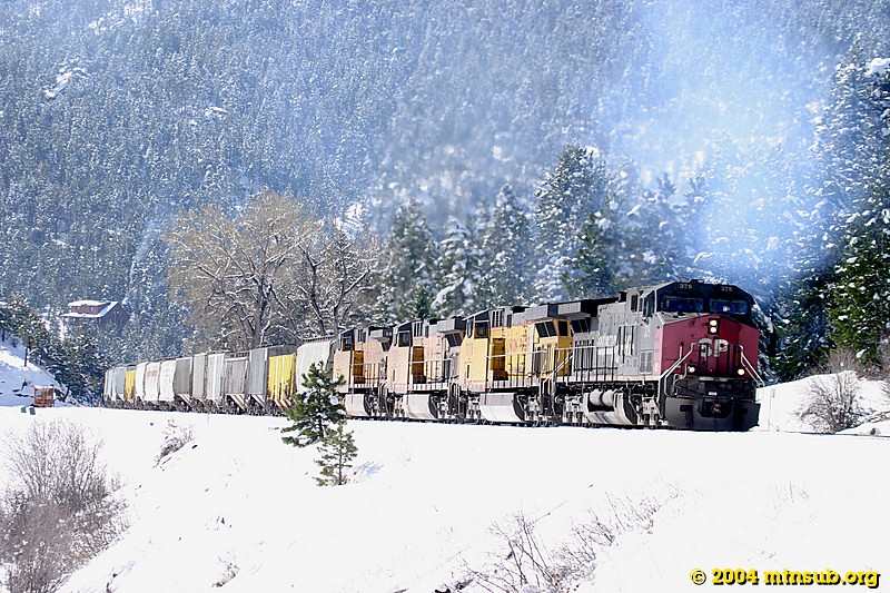 A Denver to Grand Junction mixed freight enters Crescent siding for a meet with an eastbound coal train.