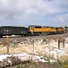 GE AC44 and an EMD SD9043MAC lead a loaded coal train downgrade at Blue Mountain.