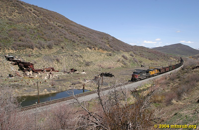 Empties bound for the Energy loader southwest of Steamboat Springs pass the abandoned mine sites at Oak Creek north of Phippsburg, CO.