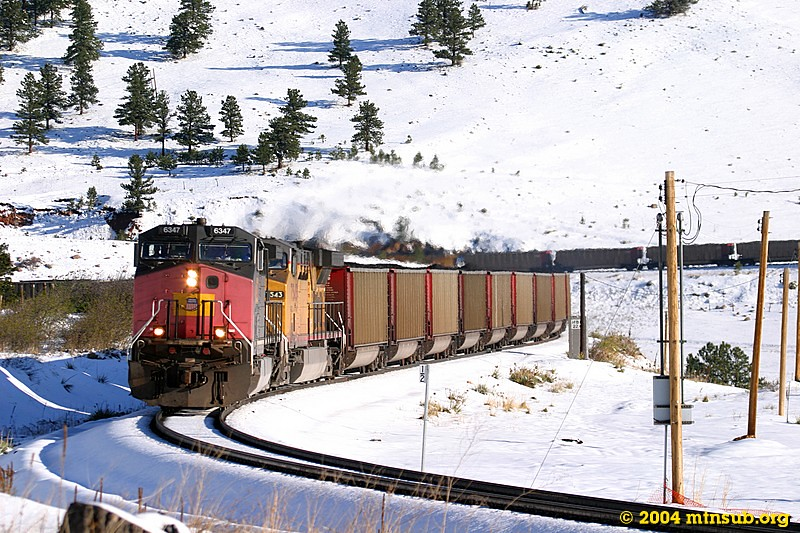A loaded coal train in full dynamics descends through the Coal Creek Canyon horseshoe.