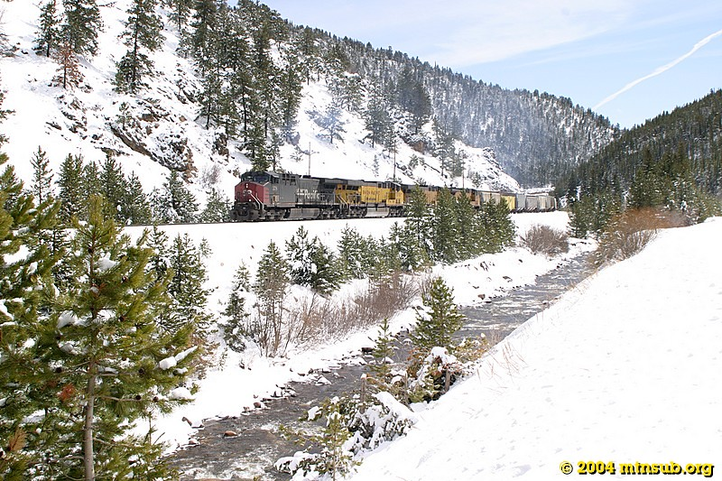 Westbound freight heading towards Moffat Tunnel in the high Rollins Valley.