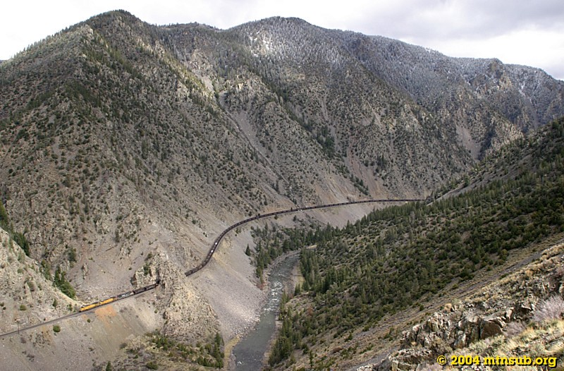 The overnight snow has nearly melted off as coal empties roll down Gore Canyon.