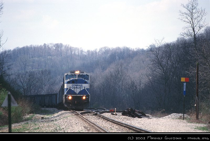 NS SD80MAC 7208 with coal drag waiting at CP WOOD, 16-Apr-2002.