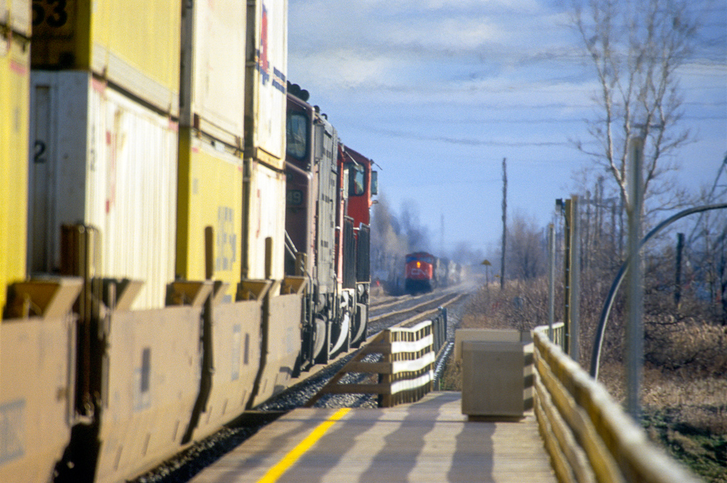 CN SD75I 5796 with intermodal eastbound meets an oncoming westbound in St. Hubert.