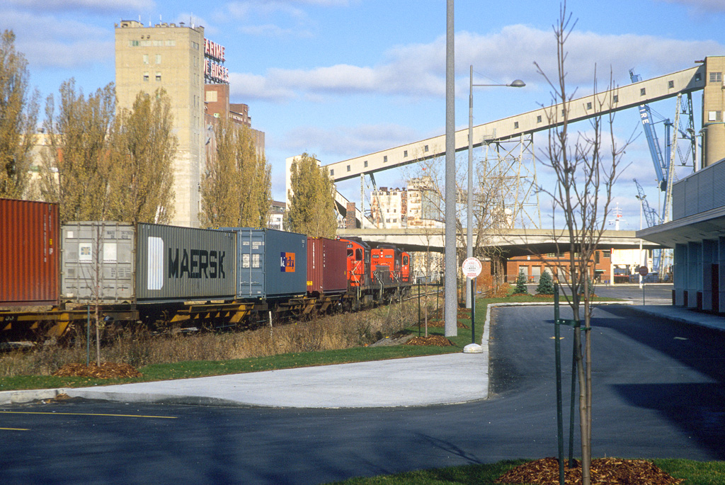 GP9RM 7228 + 7247 with slug 221 on a transfer into the Port of Montreal.