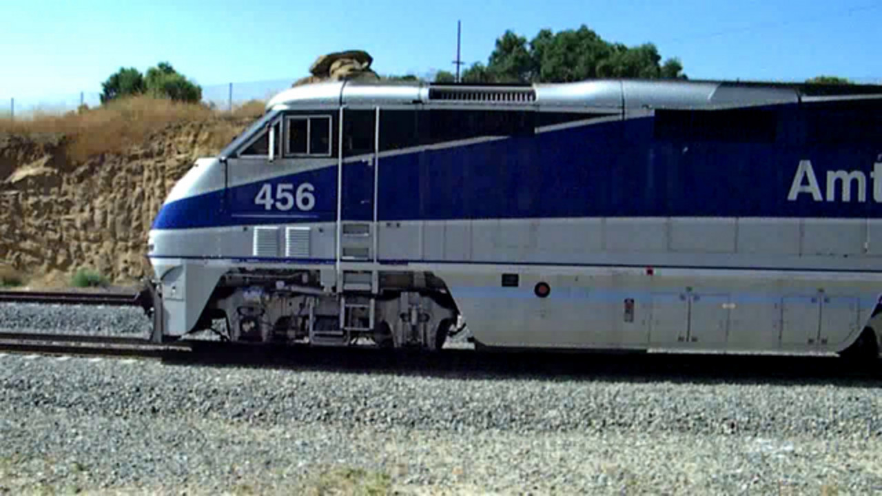 Amtrak Pacific Surfliner 775 exits Santa Susanna Pass and hustles into Simi Valley, running about 10 minutes down.